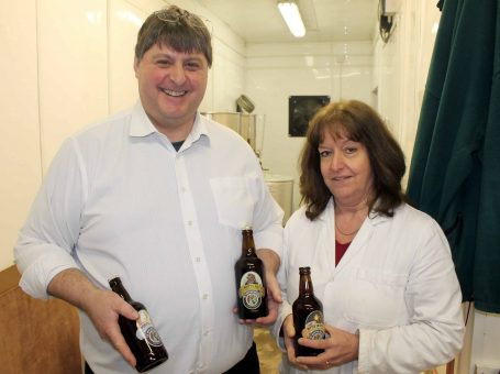 Photo of Steve and Anne - The Godstone Brewers, holding some of the beers in their brewery in Godstone, Surrey