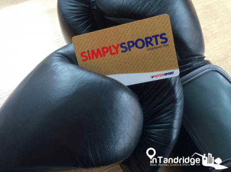 Photo of black boxing gloves with Simply Sports Loyalty Card on top. Simply Sports is a sports shop in Oxted, Surrey