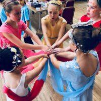 Surrey Dance School's children's ballet dancers preparing for a summer performance