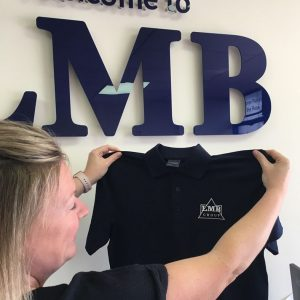 LMB Group Office with branded shirt